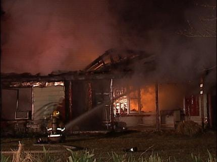 Investigating Cause Of Sand Springs House Fire