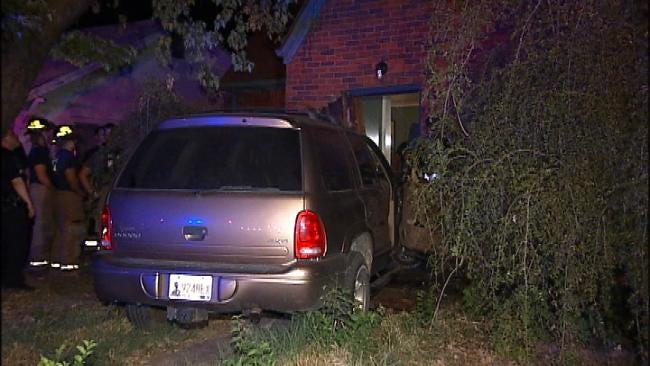 Stolen Dodge Durango Crashes Through Tulsa House