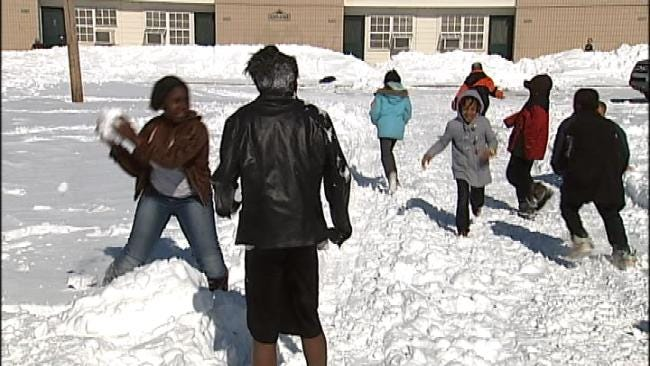 Snow-Stranded Tulsans: Kids Play While Adults Worry