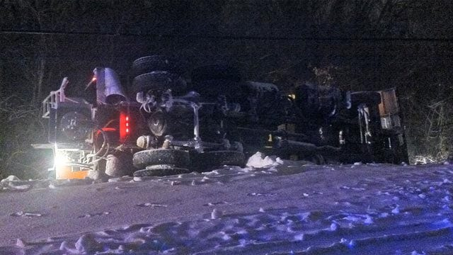 Broken Arrow Snow Plow Rolls Over, Spills Load Of Sand