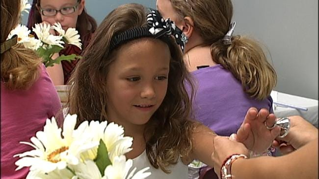 Scholl Center Hosts A Tea Party For Hearing Impaired Kids