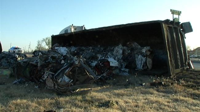 Trailer Carrying Crushed Cars Rolls Over, Closing West Tulsa Exit Ramp