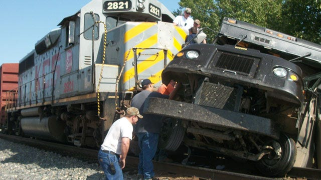 Train Hits Delivery Truck At Stilwell Crossing