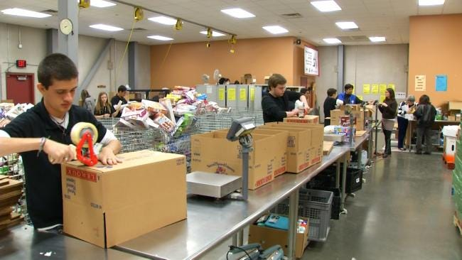 Teens From Brazil Visiting Tulsa Volunteer At Community Food Bank