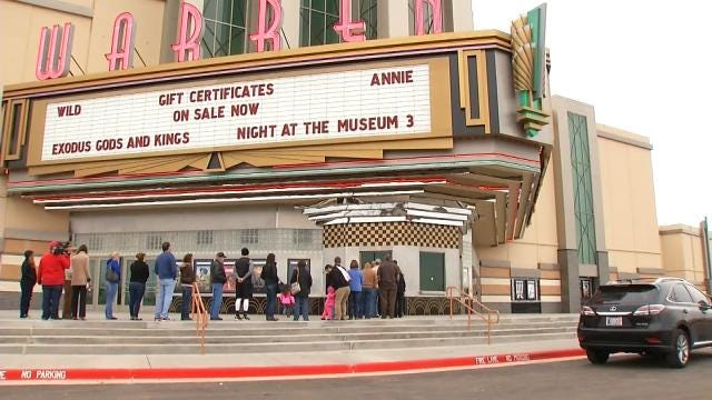 Movie Goers Line Up For Opening Of Broken Arrow's Warren Theaters