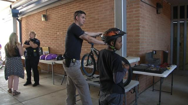 Tulsa Police Help Kids With Bicycles