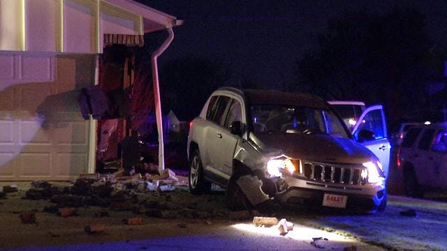 Tulsa Police Arrest 2 After SUV Slams Into House