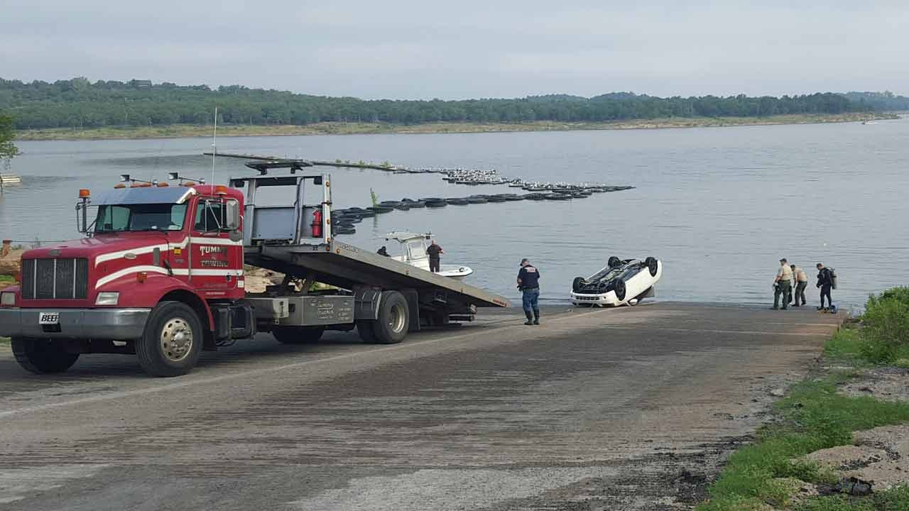 Divers Search After Car Sinks Into Keystone Lake