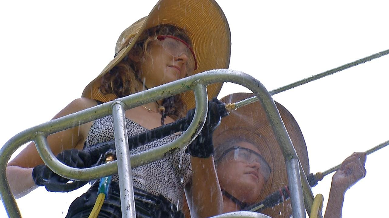 Two Artists Restoring Iconic Totem Pole Along Route 66