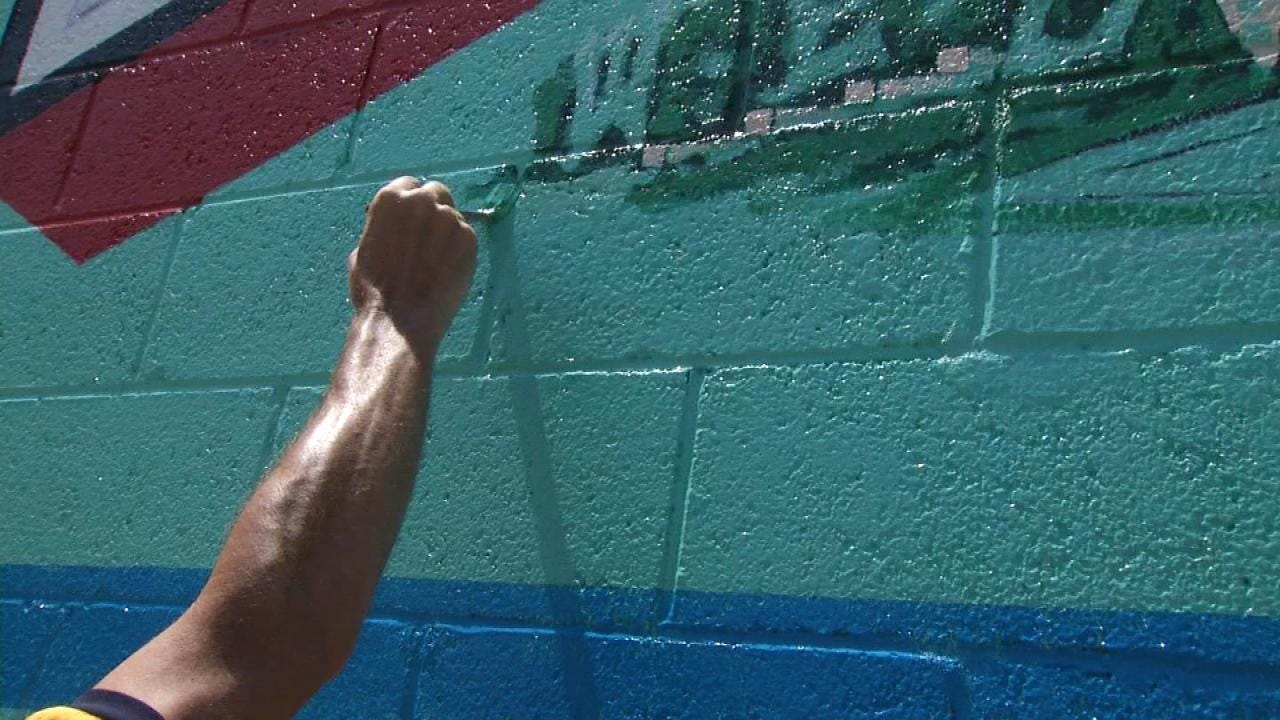 Mural Artist Adds More Flavor To Brady District