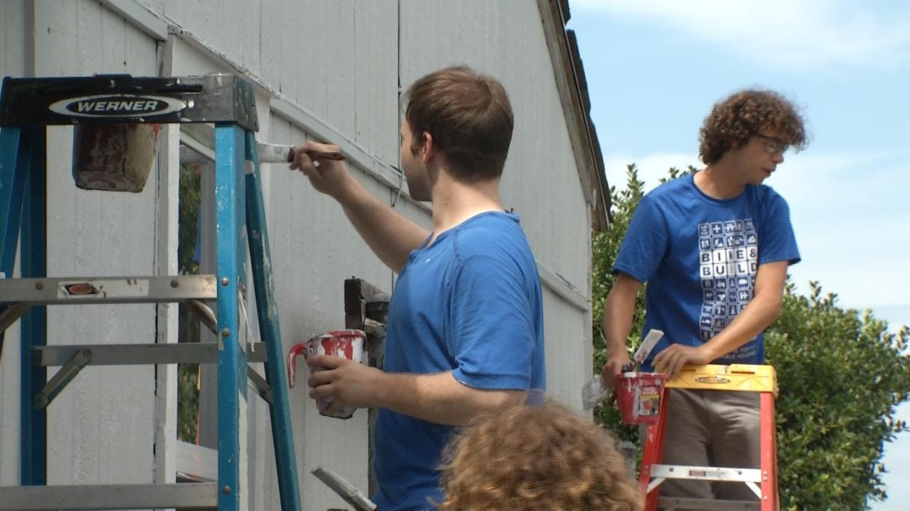 Group Bikes Across America, Stops In Tulsa To Help Senior Citizen Paint His Home