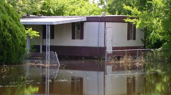 Wagoner Pumps Out Flood Waters, Families Return Home