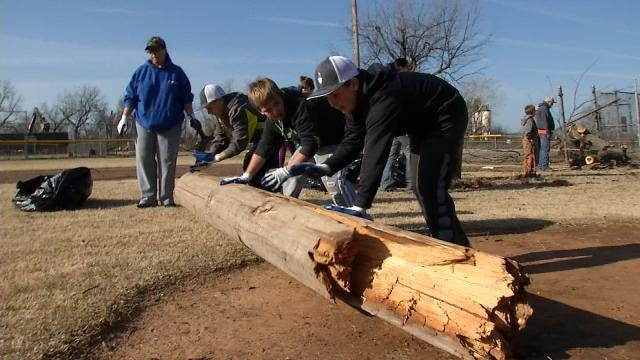 Volunteers Clean Up Tornado Debris At River City Park