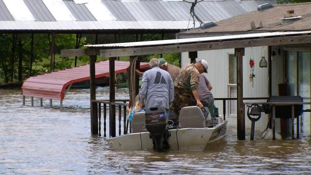 Okemah Family Wades Through Flooded Home To Salvage History