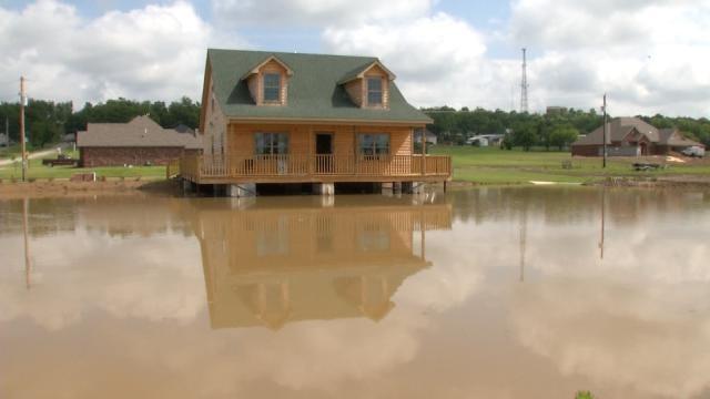 Skiatook Home Nestled Over Full Pond Thanks To Rain