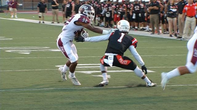 Jenks Defeats Putnam City, 66-7