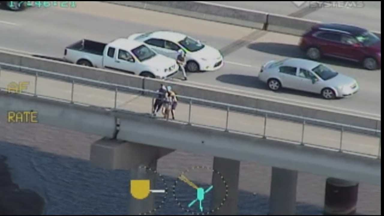 TPD Releases Video Of Men Stopping Woman From Jumping Off Bridge