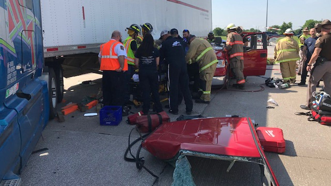 Female Passenger Trapped After Pickup, Semi Collide