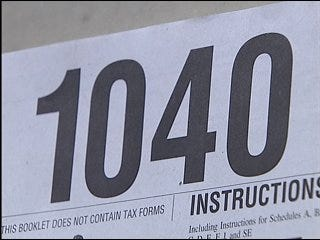 Volunteers assist in last-minute tax filings