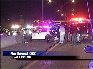 Woman pinned in highway crash