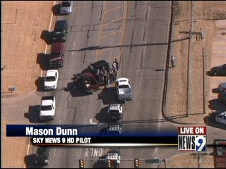 Police chase ends in crash, suspect on the run