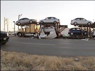 Tractor-trailer rig slams into car carrier