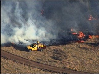 Wildfire under control after 7-hour fight