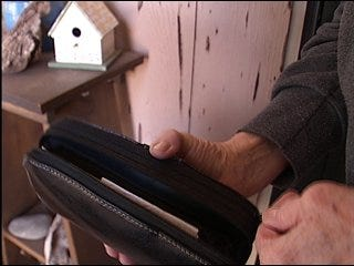 Woman returns wallet stuffed with cash