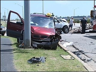 At least one hospitalized after Moore car wreck