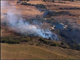 Large grass fire burns in Grady County