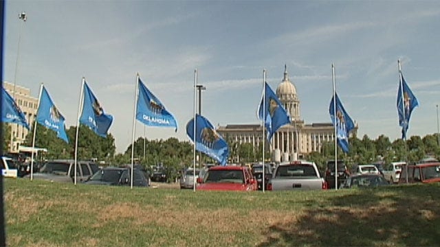 Flags Fly Near State Capitol To Bring Awareness To Child Abuse