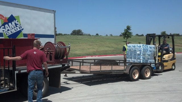 Chandler Wal-Mart Donates Water To Lincoln County Firefighters
