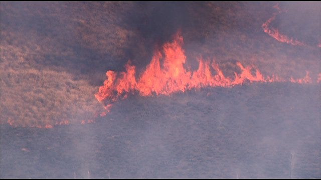 Firefighters Work To Put Out Grassfire Near Newcastle