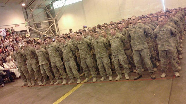 Families, Former OU Coach Greet Returning Oklahoma National Guard Soldiers