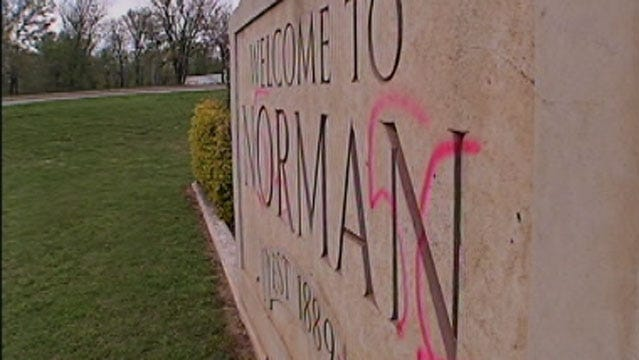 Norman Police: Racial Slurs Spray-Painted On City Sign, Cars