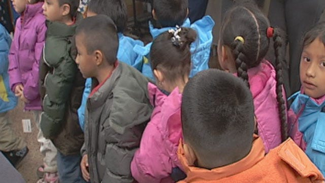 OKC Firefighters, Organization Donate Coats To Elementary School Children