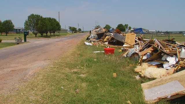 Storm Debris Remains Piled High Along Private Road In El Reno