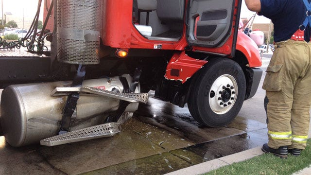 Vehicle, Semi Crash On NW Expressway, Fuel Spilled In Road