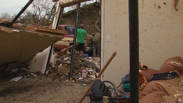 Moore Teacher Vows to Rebuild Home
