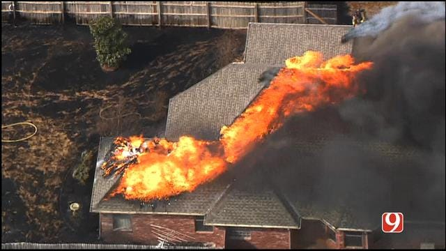 Grass Fire Catches NW OKC House On Fire