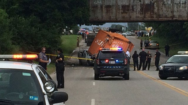 One Killed After Shipping Container Falls On Truck In OKC