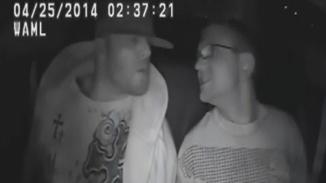 Caught On Camera: Suspects 'Kiss' To Swap Meth In Bartlesville Police Car