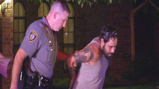 Driver Arrested After Crashing Into Parked Cars, House In NW OKC