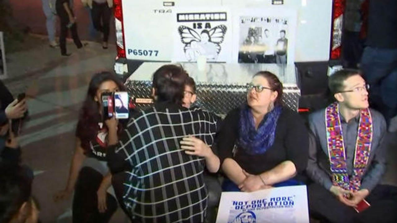 Protesters In Arizona Block Customs Van With Detained Woman Inside
