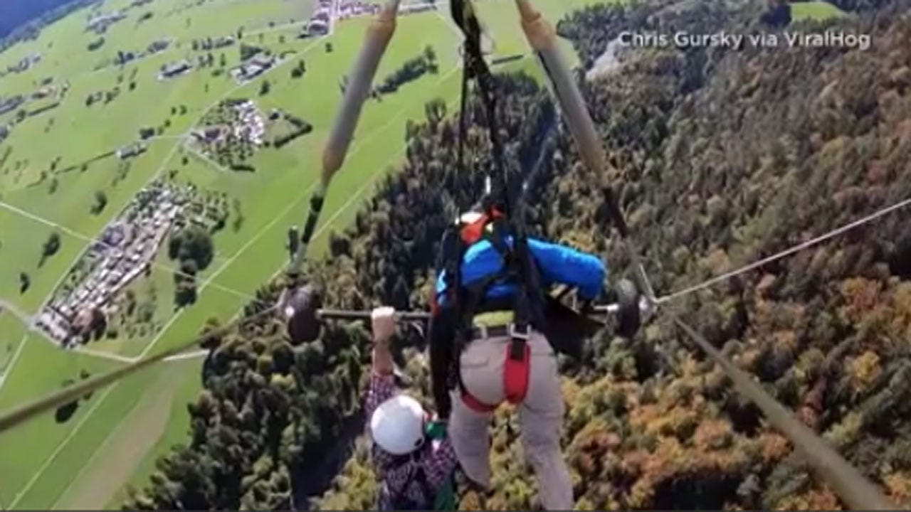 Video Shows Tourist Clinging For Life Onto Hang Glider In Switzerland